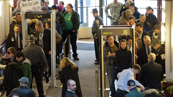 Hundreds of people line up to enter the Legislative Office Building to attend a hearing of a legislative subcommittee reviewing gun laws in Hartford, Conn., Monday, Jan. 28, 2013. (AP Photo/Jessica Hill)