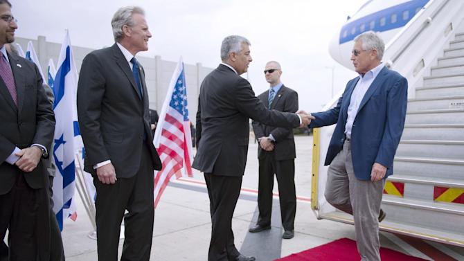 US Secretary of Defense Chuck Hagel, right, right, shakes hands with Director General of the Israeli Ministry of Defense Udi Shani as Israel Ambassador to the US Michael Oren looks on, as he arrives in Tel Aviv, Israel on April 21, 2013.  (AP Photos/Jim Watson, pool)