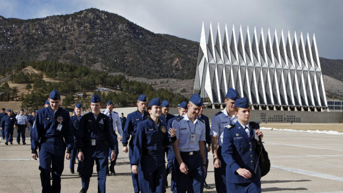 In this Friday, Jan. 20, 2012 photo cadets walk the campus at the Air Force Academy near Colorado Springs, Colo., on their way to the dinning hall for lunch. Nine years after a sexual assault scandal at the Air Force Academy sent shock waves across the military, the Defense Department reported a spike in newly reported assaults at the school and the Air Force filed sex-crime charges against three cadets.(AP Photo/Ed Andrieski)