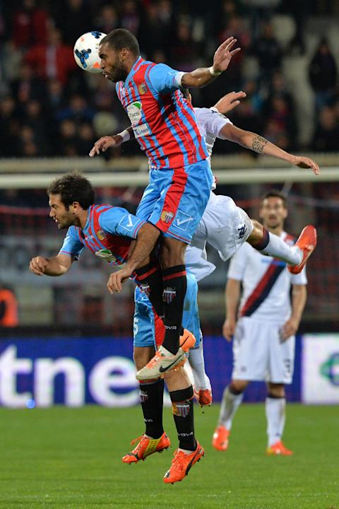 Catania defender Alexis Rolin, of Uruguay, jumps for the ball during the Serie A soccer match between Catania and Cagliari at the Angelo Massimino stadium in Catania, Italy, Saturday, March 8, 2014