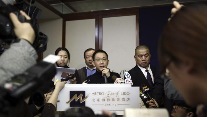 A Malaysia Airlines spokesman speaks to journalists regarding information about Malaysia Airlines flight MH370, during a news conference in Beijing