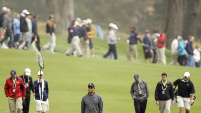 Tiger Woods walks up the second fairway during a practice round for the U.S. Open Championship golf tournament Wednesday, June 13, 2012, at The Olympic Club in San Francisco. (AP Photo/Eric Risberg)
