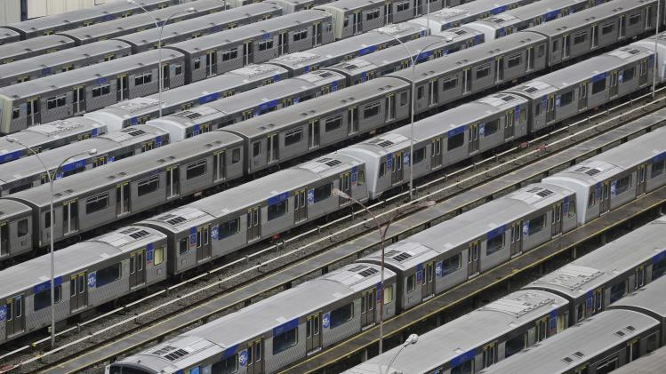 FILE - In this June 6, 2014, file photo, Metro trains sit parked on the second day of a strike by the operators in Sao Paulo, Brazil. A possible subway strike in Sao Paulo during the tournamente would cripple transportation in South America's biggest city. Authorities are counting on most fans getting to Thursday's match via the subway. Meanwhile, anti-World Cup protests were called for in at least six major cities, including Sao Paulo. (AP Photo/Nelson Antoine,File)