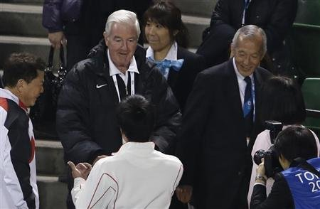 IOC Vice President Reedie of Britain shakes hands with wheelchair tennis player Kunieda of Japan after presentation of Tokyo 2020 bid to host the Summer Olympics to the commission at Ariake Tennis Par