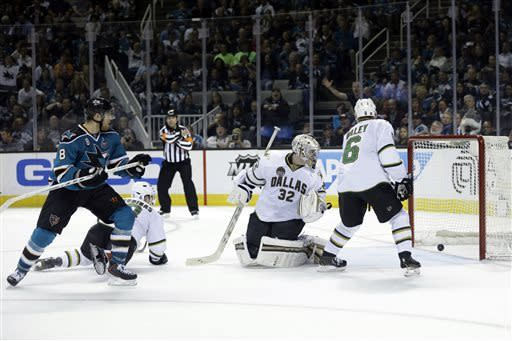 Sharks clinch playoffs with 3-2 win over Stars