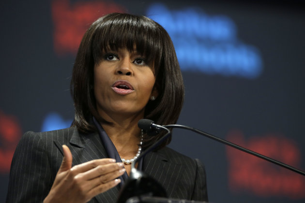 First lady Michelle Obama gestures as he speaks in her hometown of Chicago, Thursday, Feb. 28, 2013, as she makes a major announcement helping to bring back physical activity to area schools, while celebrating the third anniversary of her 'Lets Move' program. (AP Photo/M. Spencer Green)