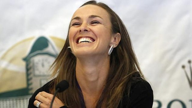 Martina Hingis laughs as she arrives at a news conference before being inducted into the Tennis Hall of Fame in Newport (Reuters)
