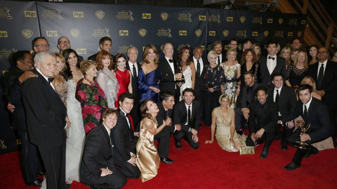 "The cast of ""Days of Our Lives"" pose backstage with their award for Outstanding Drama Series at the 42nd Annual Daytime Emmy Awards in Burbank"