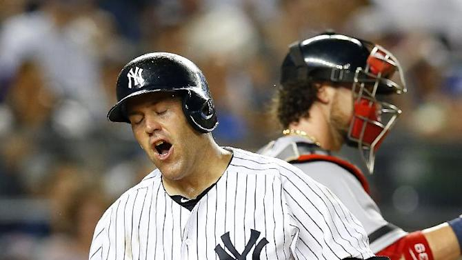 FILE - In this June 1, 2013, file photo, New York Yankees' Kevin Youkilis reacts after striking out to end the seventh inning of a baseball game against the Boston Red Sox at Yankee Stadium in New York. Youkilis needs back surgery and Mark Teixeira returned to the 15-day disabled list Tuesday, June 18, 2013, with an aching right wrist, the latest injury setbacks for the depleted Yankees. (AP Photo/Paul J. Bereswill, File)