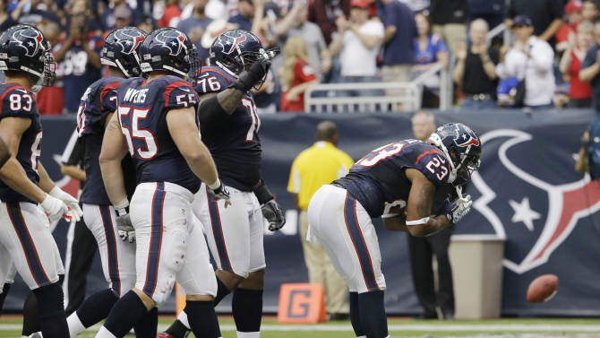 Houston Texans running back Arian Foster (23) celebrates a touchdown against the Buffalo Bills in the third quarter of an NFL football game on Sunday, Nov. 4, 2012, in Houston. (AP Photo/David J. Phillip)