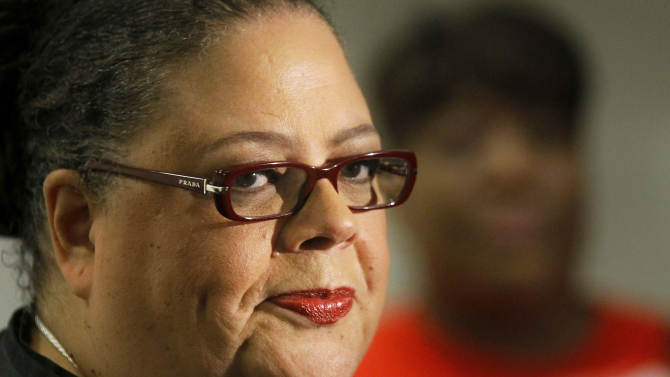 """Karen Lewis, president of the Chicago teachers union listens to a question after meeting of the union's House of Delegates Friday, Sept. 14, 2012, in Chicago. Lewis told the delegates that a """"framework"""" was in place to end the teachers strike. (AP Photo/Charles Rex Arbogast)"""