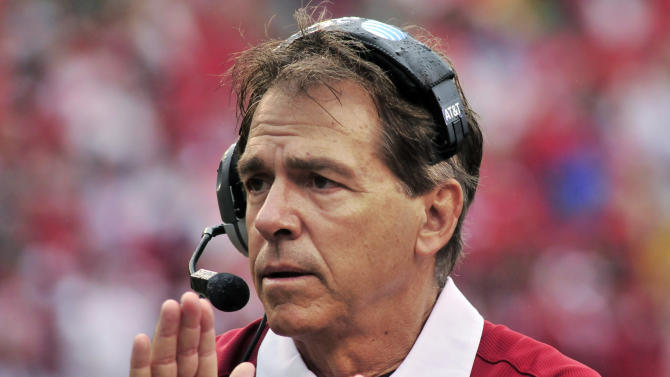 Alabama coach Nick Saban applauds during the first half of an NCAA college football game against Arkansas in Fayetteville, Ark., Saturday, Sept. 15, 2012. (AP Photo/April L. Brown)
