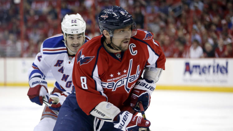 New York Rangers center Brian Boyle, left, chases Washington Capitals left wing Alex Ovechkin during the first period in Game 2 of an NHL hockey Stanley Cup first-round playoff series, Saturday, May 4, 2013, in Washington. (AP Photo/Evan Vucci)