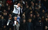 Manchester United striker Javier Hernandez celebrates scoring his second goal during their English Premier League football match against Aston Villa at Villa Park in Birmingham. Manchester United won 3-2