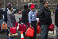 A gas line forms for free fuel from a tanker in the Far Rockaways section of the Queens borough of New York, Saturday, Nov. 10, 2012. Despite power returning to many neighborhoods in the metropolitan area, residents of the Far Rockaways continue to live without power and heat due to damage caused by Superstorm Sandy.(AP Photo/John Minchillo)