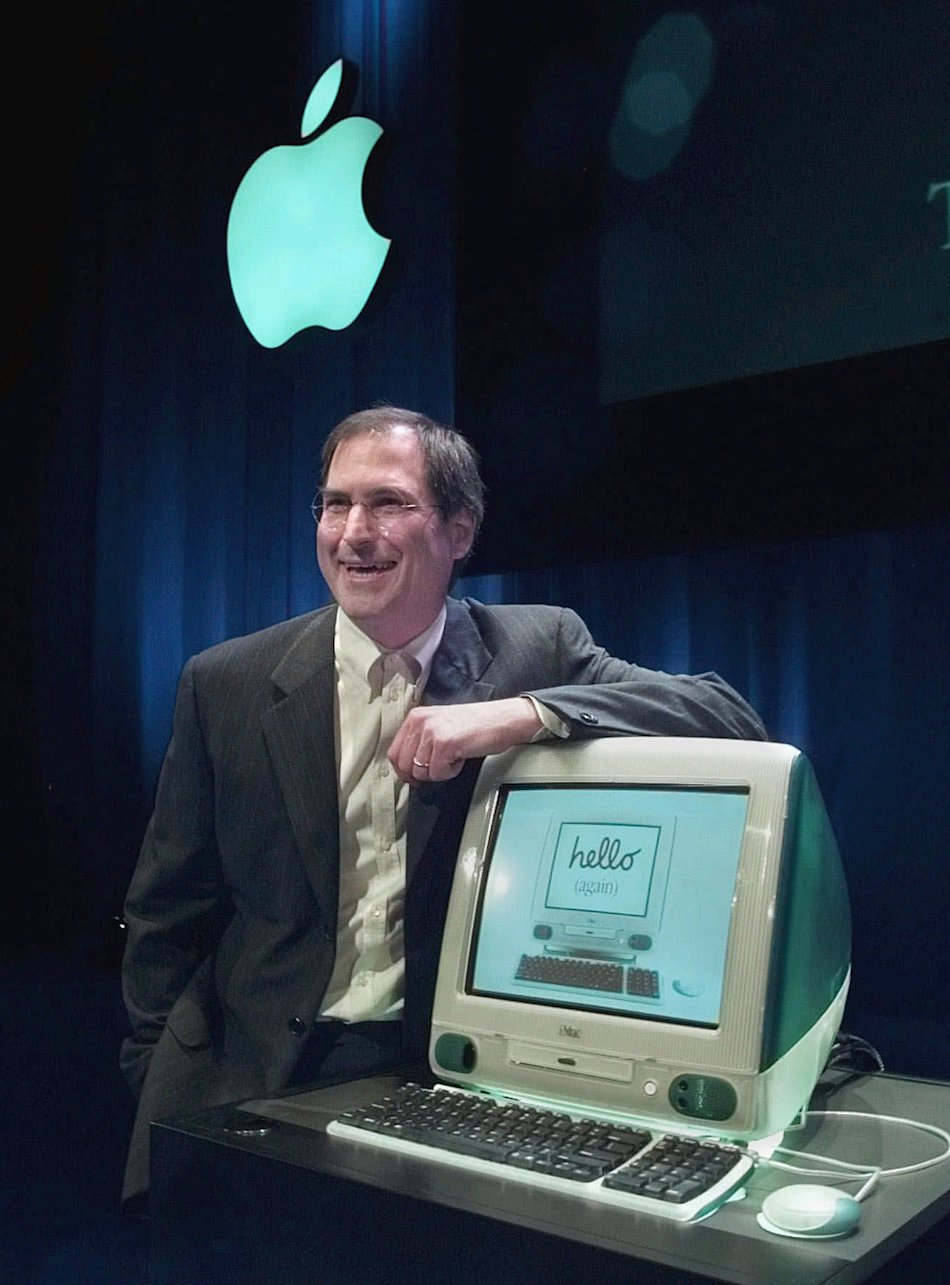 1998 - Steve Jobs of Apple Computers unveils the the new iMac computer in Cupertino, Calif. Apple on Wednesday, Oct. 5, 2011 said Jobs has died. He was 56. (AP Photo/Paul Sakuma, File)