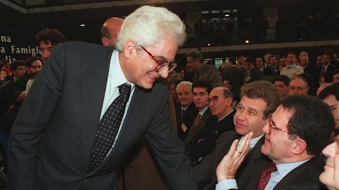 In this Jan. 10, 1997 file photo Sergio Mattarella shakes hands with former Italian Premier Romano Prodi in Rome. Italian lawmakers have elected Saturday, Jan. 31, 2015 Constitutional Court justice Sergio Mattarella on the third day of voting. Mattarella's victory was clinched Saturday when he amassed 505 votes — a simple majority — with the count incomplete. Renzi had pushed hard for Mattarella's election, and some of Renzi's rebellious Democrats had protested that the premier had imposed his choice on them. Mattarella, 73, with Christian Democrat roots, is considered to be above the political fray. (AP Photo/Enrico Oliverio, file)