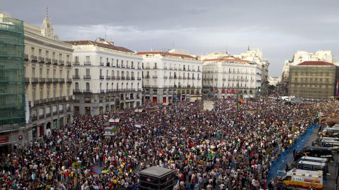 Protesters pack the Puerta del Sol plaza in central Madrid, Saturday May 12, 2012. The protesters returned to Sol to mark the anniversary of the protest movement that inspired groups in other countries. The protests began May 15 last year and drew hundreds and thousands of people calling themselves the indignant movement. The demonstrations spread across Spain and Europe as anti-austerity sentiment grew. (AP Photo/Paul White)