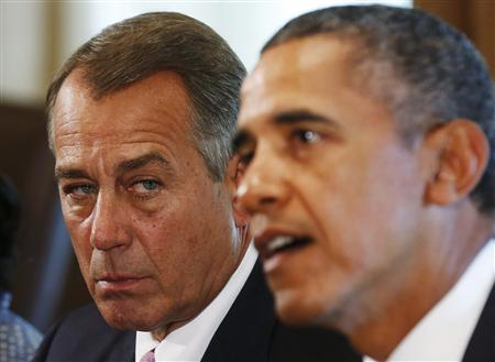 Speaker of the House Boehner listens to U.S. President Obama at a meeting with bipartisan Congressional leaders in Washington