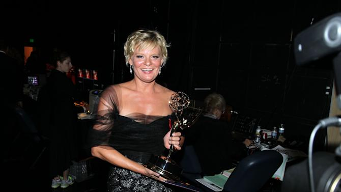 "Martha Plimpton poses backstage with her award for outstanding guest actress in a drama series for playing Patti Nyholm on ""The Good Wife"" at the 2012 Creative Arts Emmys at the Nokia Theatre on Saturday, Sept. 15, 2012, in Los Angeles. (Photo by Matt Sayles/Invision/AP)"