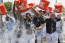 FILE - This Aug. 20, 2014 file photo shows Tennessee Titans players taking part in the ALS Ice Bucket Challenge after NFL football practice in Nashville, Tenn. Former Titans linebacker Tim Shaw has announced that he has ALS and visited the facility and witnessed the event to raise money and awareness to battle the disease. The phenomenal success of the fundraising craze is making charitable organizations rethink how they connect with a younger generation of potential donors, specifically through social media. (AP Photo/Mark Humphrey, File)