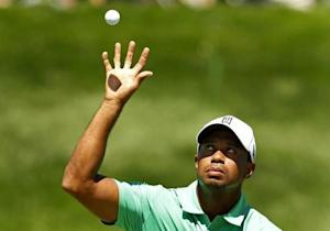 Woods of the U.S. catches his ball on the fifth green during the third round of the Barclays PGA golf tournament in Jersey City