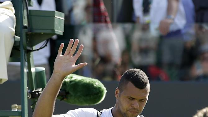 Jo-Wilfried Tsonga of France leaves the court after losing to Ivo Karlovic of Croatia during their singles match at the All England Lawn Tennis Championships in Wimbledon, London, Saturday July 4, 2015. Karlovic won the match 7-6, 4-6, 7-6, 7-6. (AP Photo/Pavel Golovkin)