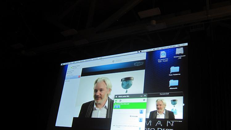 Fugitive WikLeaks founder Julian Assange speaks via Skype at the South By SouthWest Interactive festival in Austin, Texas, Saturday, March 8, 2014. Assange's appearance underscores the increasing attention that the technology industry is paying to issues of online privacy, security and surveillance. (AP Photo/Barbara Ortutay)