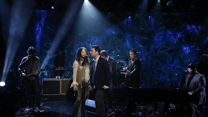 """In this photo provided by NBC, from second left, Steven Tyler, Jimmy Fallon, Bruce Springsteen and Billy Joel perform during """"Hurricane Sandy: Coming Together"""" Friday, Nov. 2, 2012, in New York. Hosted by Matt Lauer, the event is heavy on stars identified with New Jersey and the New York metropolitan area, which took the brunt of this week's deadly storm. (AP Photo/NBC, Heidi Gutman)"""