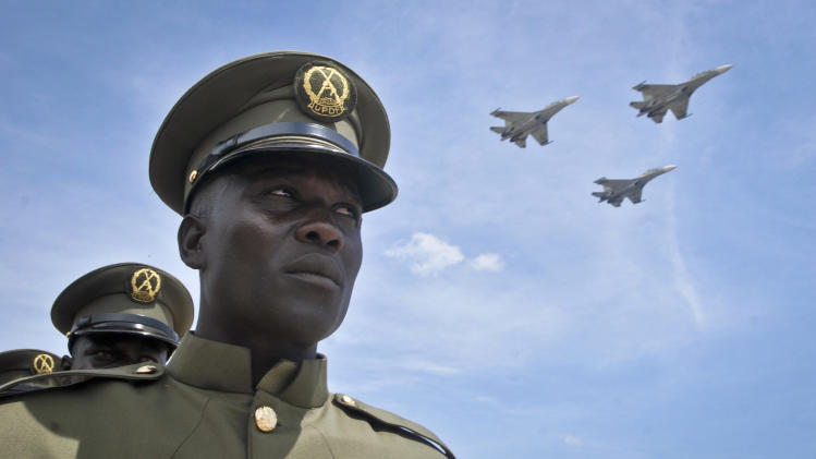 Ugandan jets fly past a military parade of the Uganda People's Defence Force to celebrate the 50th anniversary of the country's independence from British rule, in Kampala, Uganda, Tuesday, Oct. 9, 2012. The East African country has come a long way from the days when brutal dictators were in charge, but it has not had a single peaceful transfer of power since 1962, and the potential for instability remains as opposition activists intensify their campaigns and authorities clamp down. (AP Photo/Stephen Wandera)