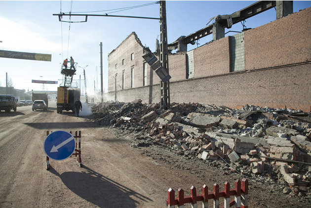 In this photo provided by Chelyabinsk.ru municipal workers repair damaged electric power circuit outside a zinc factory building with about 600 square meters (6000 square feet) of a roof collapsed  af