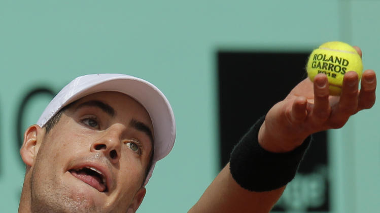 USA's John Isner serves the ball to France's Paul-Henri Mathieu during their second round match in the French Open tennis tournament at the Roland Garros stadium in Paris, Thursday, May 31, 2012. (AP Photo/Michel Euler)