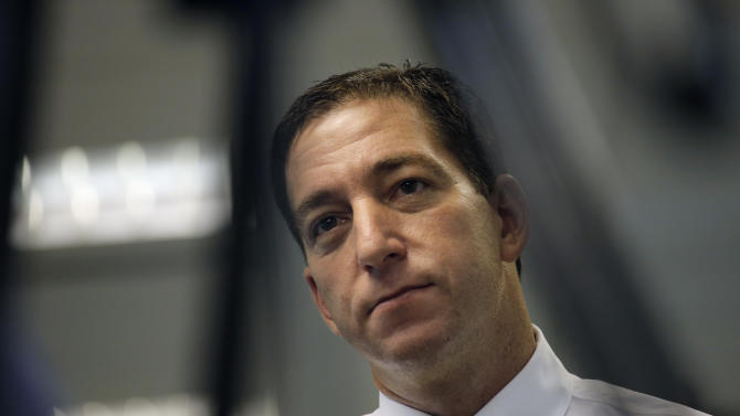 """FILE - In this June 11, 2013, file photo Britain's The Guardian newspaper reporter Glenn Greenwald talks to The Associated Press in Hong Kong. Greenwald first reported former NSA contractor Edward Snowden's disclosure of NSA's government surveillance programs. On the Sunday talk show """"Meet the Press"""", June 23, 2013, host David Gregory asked Greenwald why he shouldn't be charged with a crime for having """"aided and abetted"""" Snowden. Greenwald replied that it was """"pretty extraordinary that anybody who would call themselves a journalist would publicly muse about whether or not other journalists should be charged with felonies."""" (AP Photo/Vincent Yu, File)"""