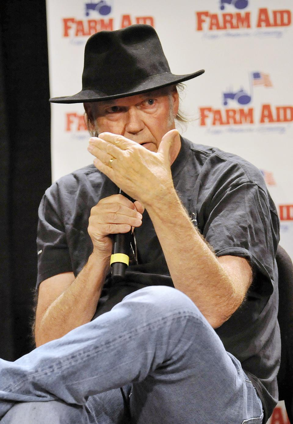 Neil Young talks with reporters during a news conference prior to the start of the Farm Aid 2013 concert at Saratoga Performing Arts Center in Saratoga Springs, N.Y., Saturday, Sept. 21, 2013. (AP Photo/Hans Pennink)