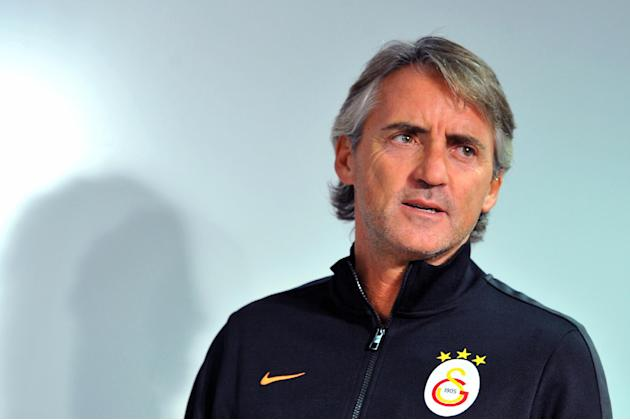 Galatasaray coach Roberto Mancini arrives for a press conference ahead of Wednesday's Champions League, group B soccer match between Juventus and Galatasaray, at the Juventus stadium, in Turin, Italy,