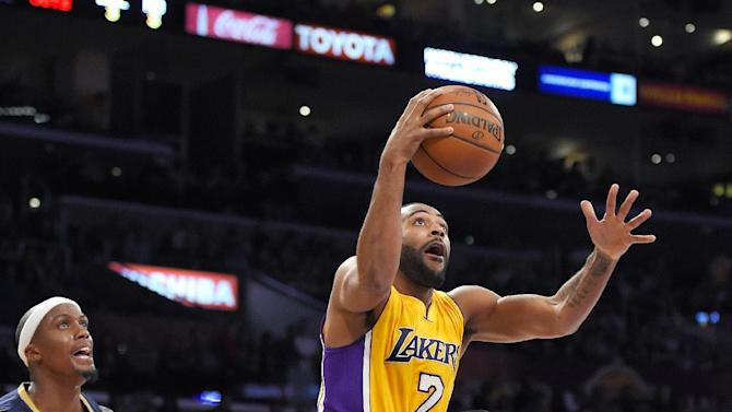 Los Angeles Lakers guard Wayne Ellington, right, goes up for a shot as New Orleans Pelicans forward Dante Cunningham watches during the second half of an NBA basketball game, Wednesday, April 1, 2015, in Los Angeles. The Pelicans won 113-92. (AP Photo/Mark J. Terrill)
