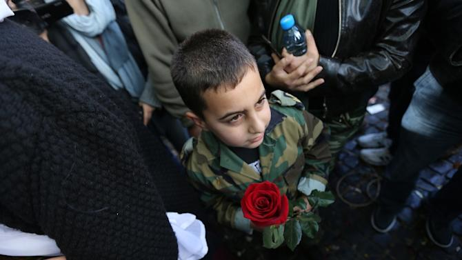 A young boy awaits a relative in downtown Beirut as Lebanese soldiers and policemen kidnapped by jihadist groups from the eastern border town of Arsal are released, on December 1, 2015