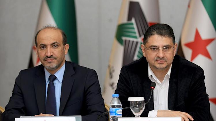 A handout picture released by the Syrian National Coalition shows SNC president Ahmad Jarba (L) and Secretary general Badr Jamus at their general assembly on January 18, 2014 at a hotel in a suburb of Istanbul
