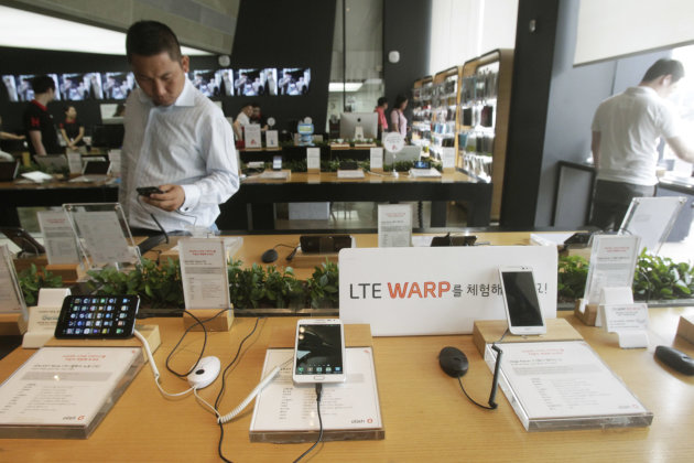 Long Term Evolution smartphones are displayed at the headquarters of South Korean mobile carrier KT in Seoul, South Korea, Thursday, June 21, 2012. South Korea is forecasting blistering growth in the use of LTE, a network technology that gives the fastest speeds for connecting to the Internet from a mobile device. South Korea was not the first to use the fourth generation mobile technology Long Term Evolution and the United States eclipses South Korea in sheer number of LTE smartphone users. (AP Photo/Ahn Young-joon)