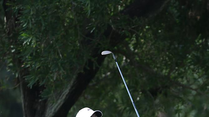 Rory McIlroy of Northern Ireland follows his ball on the 1st hole during the final round of the Dubai Desert Classic golf tournament in United Arab Emirates, Sunday, Feb. 1, 2015. (AP Photo/Kamran Jebreili)