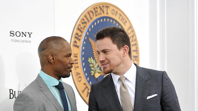 """Actors Jamie Foxx, left, and Channing Tatum attend the """"White House Down"""" premiere at the Ziegfeld Theatre on Tuesday, June 25, 2013 in New York. (Photo by Evan Agostini/Invision/AP)"""