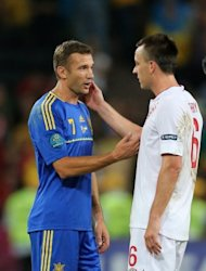 Andriy Shevchenko congratulates England&#39;s John Terry after the Euro 2012 match in Donetsk on June 19. Shevchenko is to join a pro-business party called Ukraine Forward! whose leader, Nataliya Korolevska, has broken away from the opposition party of jailed ex-prime minister Yulia Tymoshenko