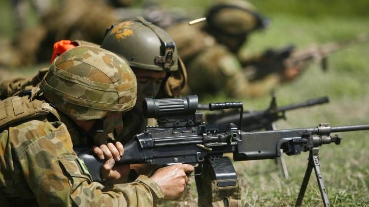 Australian Army soldiers fire their weapons in a live fire exercise at Marine Corps Base Hawaii