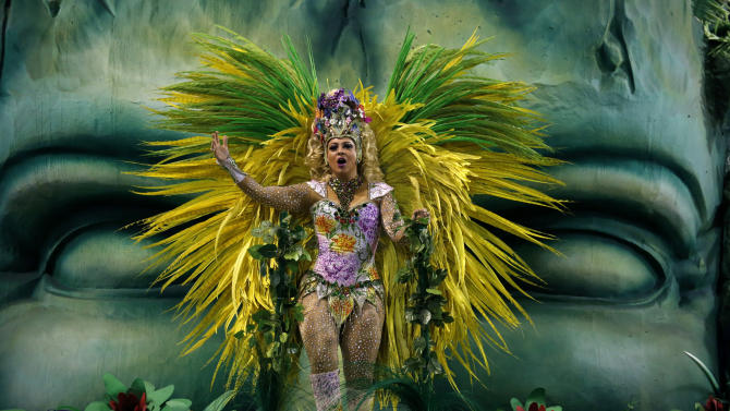 A reveller of the Unidos da Tijuca samba school performs during the carnival parade at the Sambadrome in Rio de Janeiro