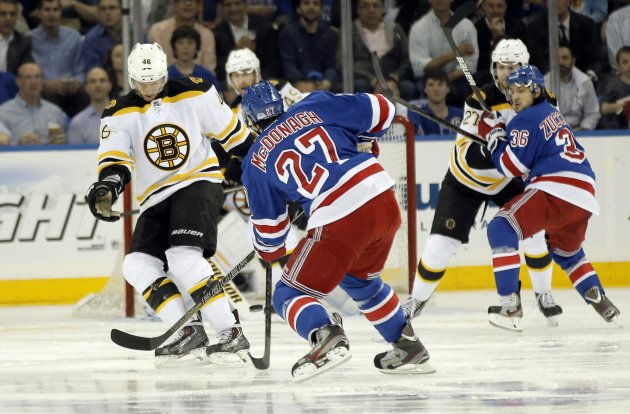 Boston Bruins' David Krejci  blocks a shot by New York Rangers'  Ryan McDonagh during action in the first period of Game 3 of their NHL Eastern Conference semi-final playoff hockey series in New York,