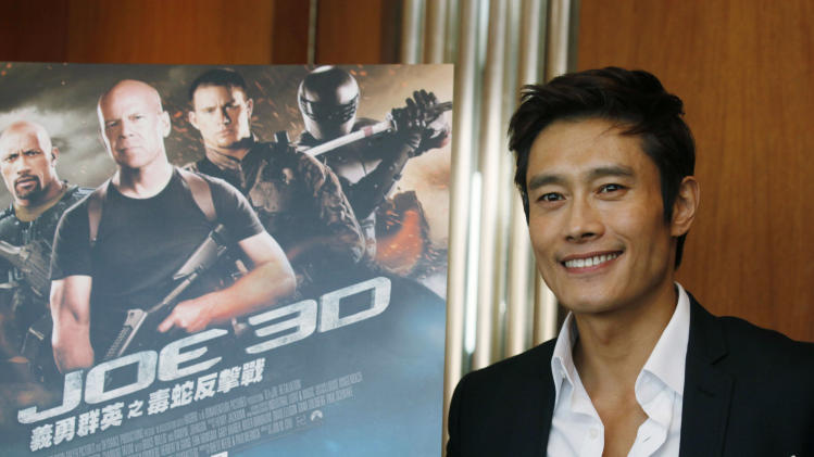 """FILE - In this  Dec. 12, 2012 file photo, South Korea actor Lee Byung-hun poses for photographers after an interview for his latest film """"G.I. Joe: Retaliation"""" in Hong Kong. Lee says he had to train hard to do justice to his character in """"G.I. Joe: Retaliation."""" The upcoming sequel to """"G.I. Joe: The Rise of Cobra"""" has Storm Shadow rising from the dead and out for vengeance. And it required the South Korean actor develop a stronger build. (AP Photo/Kin Cheung, File)"""