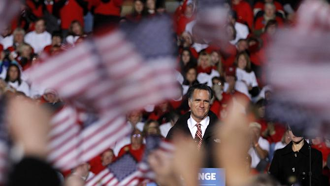 Supporters wave American flags as Republican presidential candidate, former Massachusetts Gov. Mitt Romney speaks during a campaign event in West Chester, Ohio, Friday, Nov. 2, 2012.  (AP Photo/Mary Altaffer)