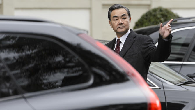 Chinese Foreign Minister Wang Yi arrives at a hotel for a new round of talks on the Iranian nuclear program in Lausanne, Switzerland, Sunday, March 29, 2015. (AP Photo/Keystone, Jean-Christophe Bott)