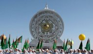Young Turkmens take part in unveiling ceremony of the 47.6-metre Ferris wheel in an enclosed space called Alem (The Universe ) in the Turkmenistan's capital Ashgabat. Turkmenistan, an authoritarian ex-Soviet state with a knack for setting peculiar Guinness World Records, on Friday unveiled the planet's largest Ferris wheel in an enclosed space