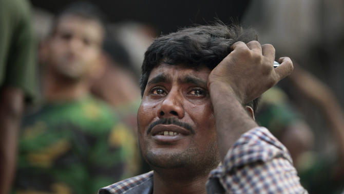 A Bangladeshi relative of a victim cries at the site of a building that collapsed Wednesday in Savar, near Dhaka, Bangladesh,Thursday, April 25, 2013. By Thursday, the death toll reached at least 194 people as rescuers continued to search for injured and missing, after a huge section of an eight-story building that housed several garment factories splintered into a pile of concrete.(AP Photo/A.M.Ahad)